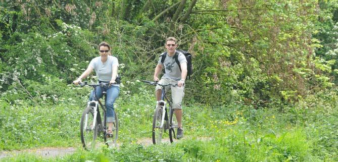Cyclists along bike trail bath